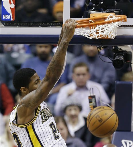 Indiana Pacers' Paul George (24) dunks during the first half of an NBA basketball game against the Atlanta Hawks, Monday, March 25, 2013, in Indianapolis. (AP Photo/Darron Cummings)
