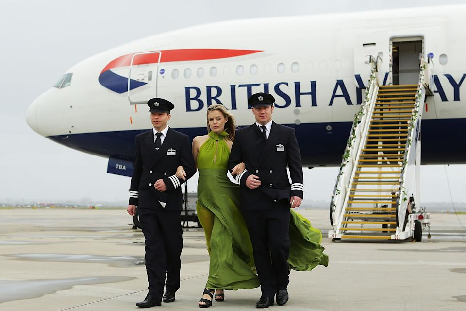 A BA ad featuring Georgia May Jagger flanked by pilots. Photo: Getty