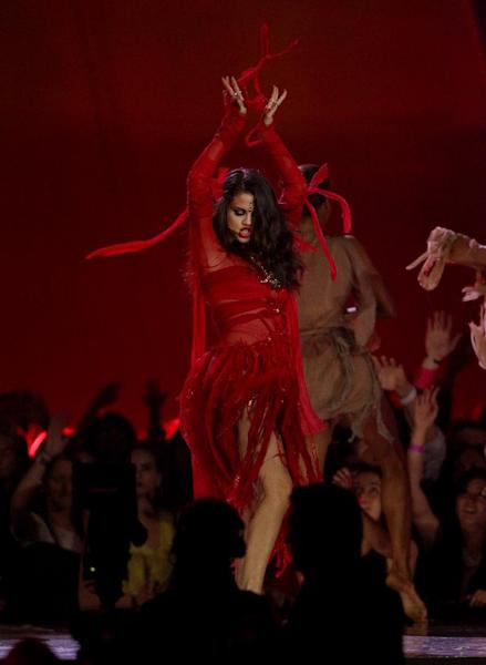 """Selena Gomez performs """"Come and Get It"""" at the MTV Movie Awards in Sony Pictures Studio Lot in Culver City, Calif., on Sunday April 14, 2013. (Photo by Matt Sayles/Invision /AP)"""