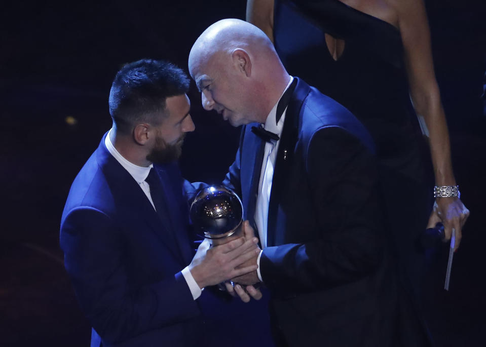 Argentinian Barcelona player Lionel Messi receives the Best FIFA mens player award from FIFA president Gianni Infantino during the ceremony of the Best FIFA Football Awards, in Milan's La Scala theater, northern Italy, Monday, Sept. 23, 2019. (AP Photo/Antonio Calanni)