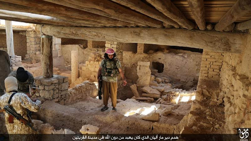 IS jihadists prepare to destroy the ancient Syriac Catholic monastry of Mar Elian in the central Syrian town of Al-Qaryatain in this jihadist Welayat Dimashq media image from August 21, 2015 (AFP Photo/)