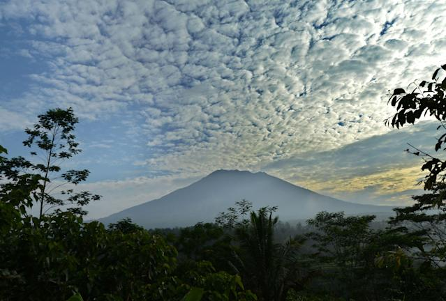 <p>A general view shows Mount Agung from Karangasem on the Indonesian resort island of Bali on September 24, 2017.<br> Authorities have raised alert levels for a volcano on the Indonesian resort island of Bali after hundreds of small tremors stoked fears it could erupt for the first time in more than 50 years. / AFP PHOTO / SONNY TUMBELAKA (Photo credit should read SONNY TUMBELAKA/AFP/Getty Images) </p>