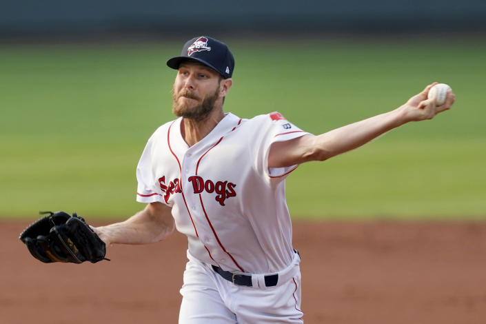 Boston Red Sox starting pitcher Chris Sale throws during the second inning of rehab start with the Portland Sea Dogs as he recovers from Tommy John surgery, during the team's minor league baseball game against the Harrisburg Senators, Tuesday, July 20, 2021, in Portland, Maine. (AP Photo/Mary Schwalm)