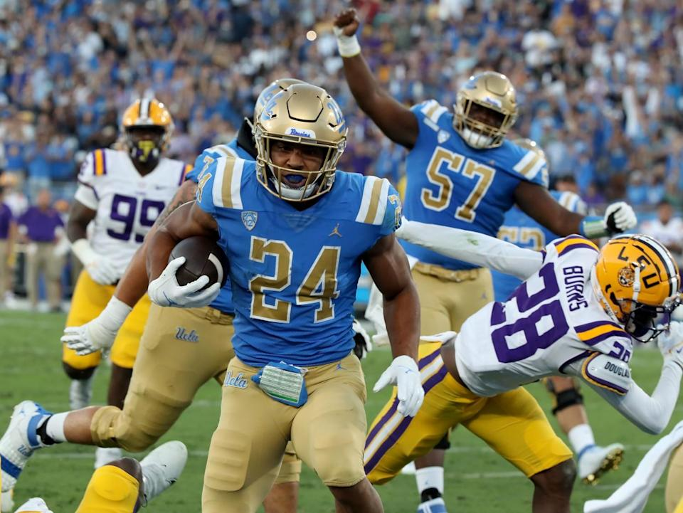 UCLA running back Zach Charbonnet runs untouched into the end zone.