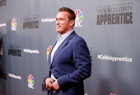 "File Photo: Host Arnold Schwarzenegger poses after a panel for ""The New Celebrity Apprentice"" in Universal City"