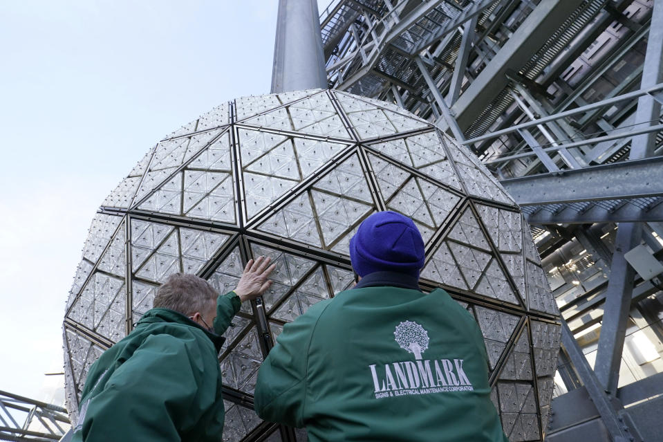 Workers secure a panel of Waterford crystal triangles on the Times Square New Year's Eve ball, Sunday, Dec. 27, 2020, in New York. (AP Photo/Kathy Willens)