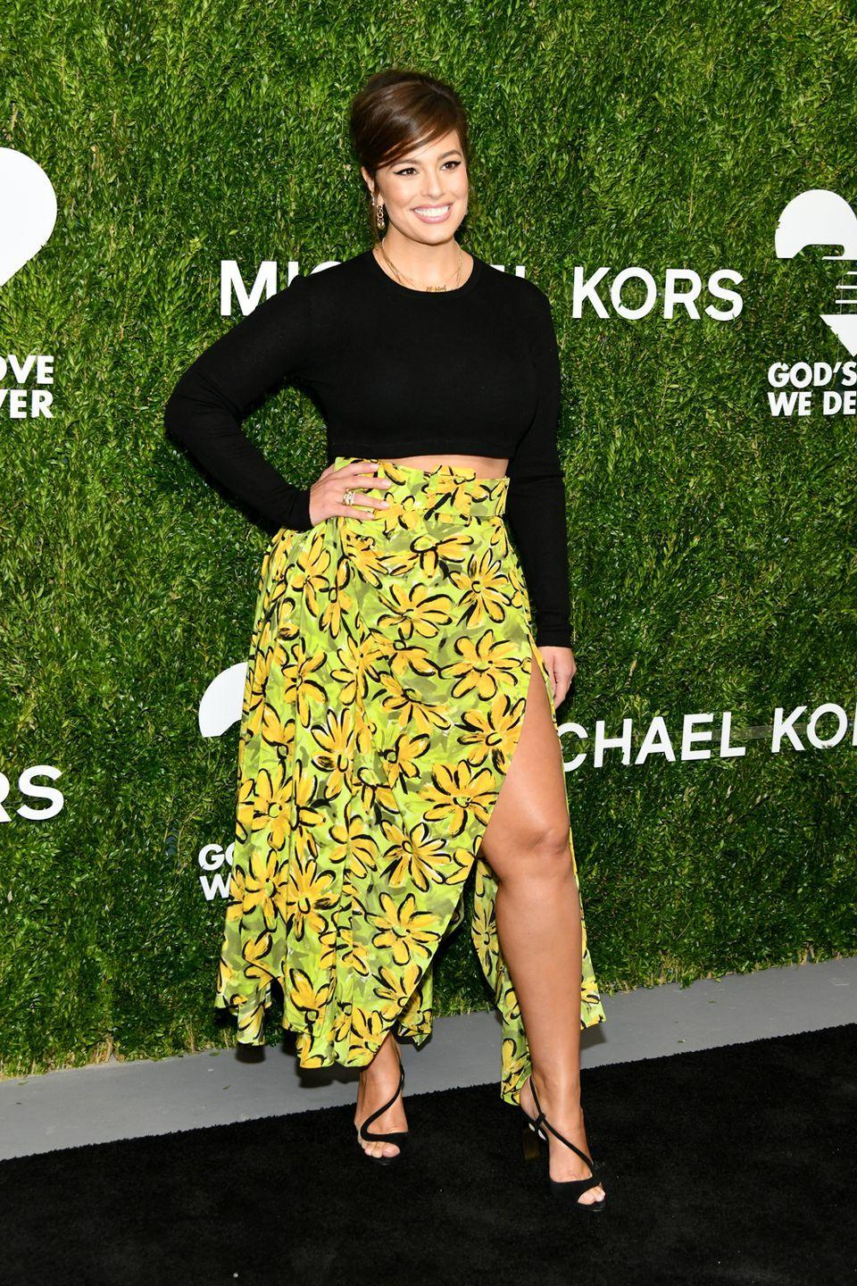 <p>Attending the 12th Annual Golden Heart Awards: We know that Ashley loves a thigh-high split, so this green floral skirt had her name all over it. She kept the rest of the look casual with a black cropped jumper and heels.</p>
