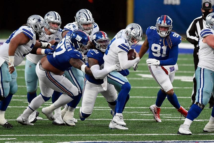 New York Giants defensive end Leonard Williams (99) sacks Dallas Cowboys quarterback Andy Dalton (14) in the second half. The Giants defeat the Cowboys, 23-19, at MetLife Stadium on Sunday, January 3, 2021, in East Rutherford.
