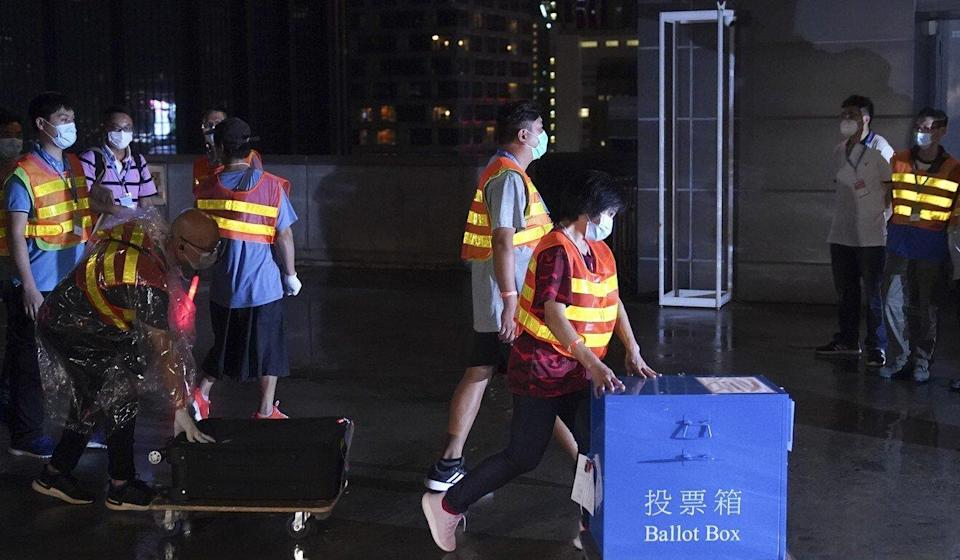 Ballot boxes are brought to the central counting station in Wan Chai. Photo: Sam Tsang