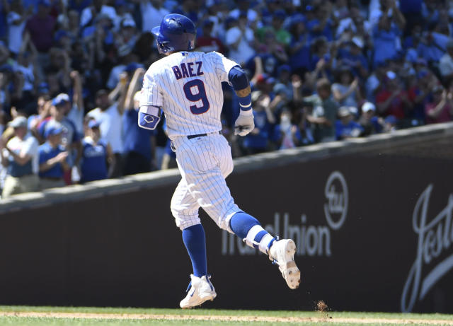 Chicago Cubs' Javier Baez (9) runs the bases after hitting a home run against the Cincinnati Reds during the seventh inning of a baseball game Saturday, July 7, 2018, in Chicago. (AP Photo/David Banks)