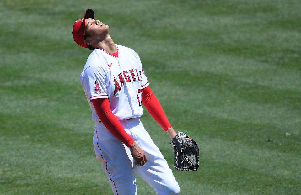 ANAHEIM, CA - AUGUST 02:  Shohei Ohtani #17 of the Los Angeles Angels reacts after giving up a bases loaded walk scoring Michael Brantley #23 of the Houston Astros in the second inning of the game at Angel Stadium of Anaheim on August 2, 2020 in Anaheim, California. (Photo by Jayne Kamin-Oncea/Getty Images)