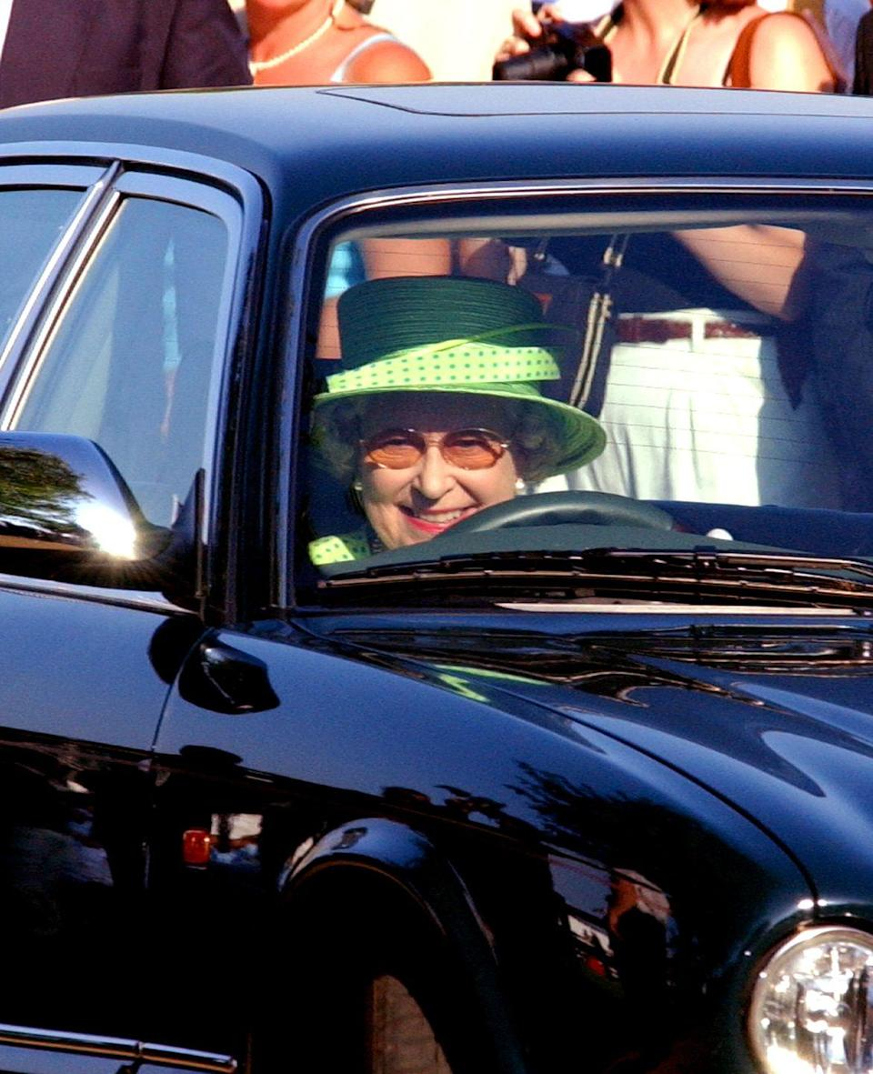 <p>Wearing a Kelly green hat, the Queen sat behind the wheel, headed to a polo match at the Guards Polo Club. </p>