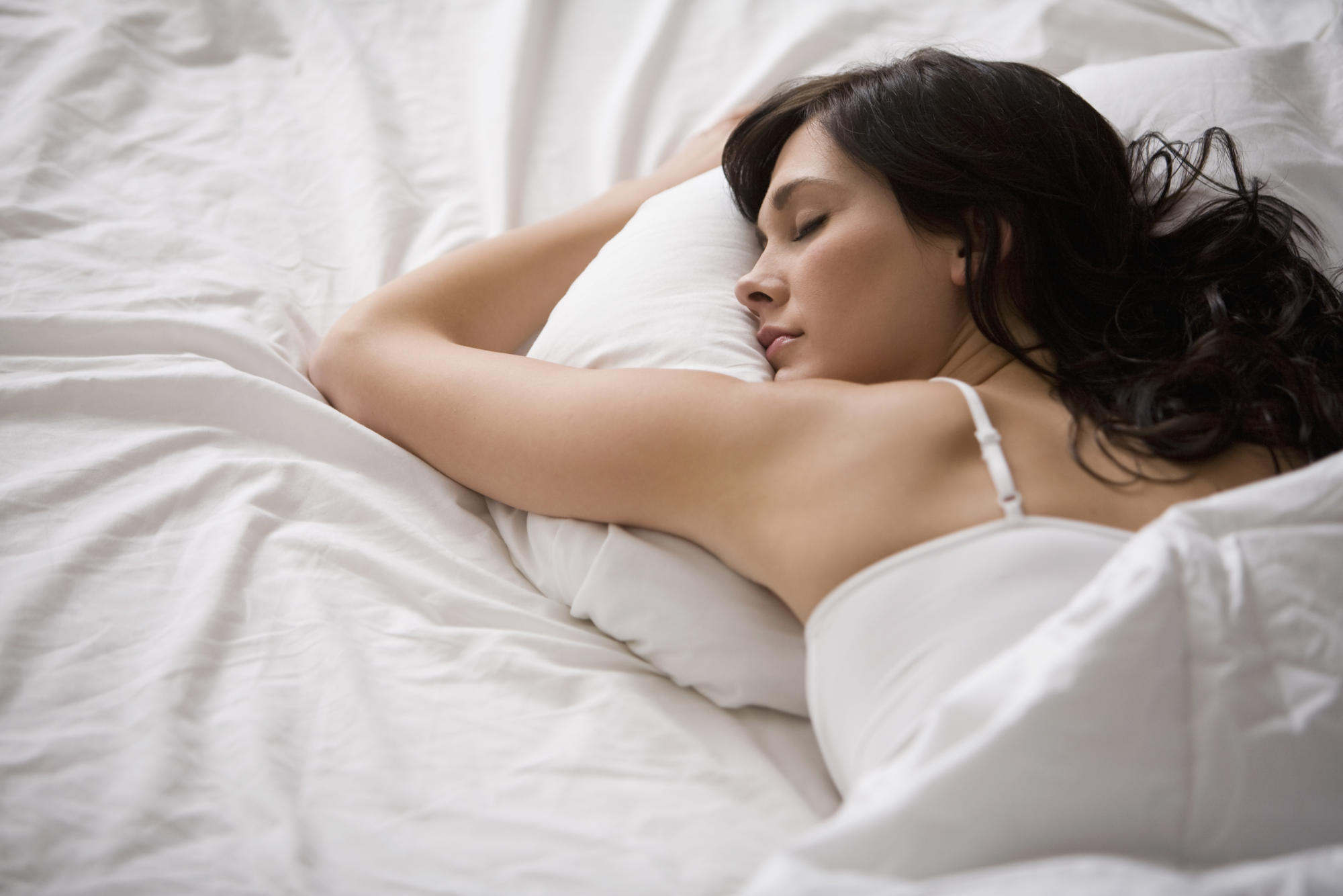 Sleep for just six to seven hours a night to maximise heart health, study suggests