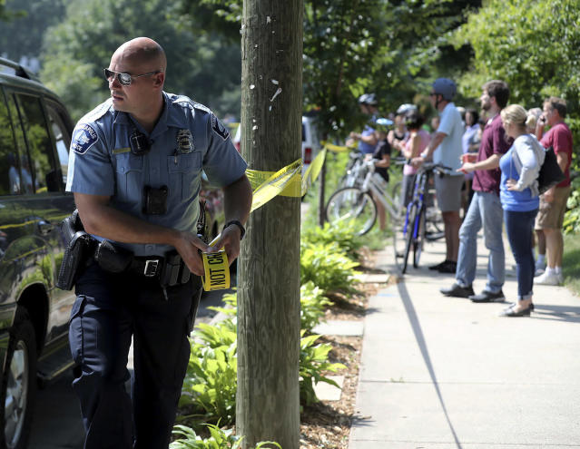 <p>A Minneapolis police officer puts up police tape following an explosion at Minnehaha Academy, Aug. 2, 2017, in Minneapolis. (David Joles/Star Tribune via AP) </p>