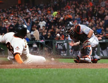 Jun 19, 2018; San Francisco, CA, USA; San Francisco Giants third baseman Pablo Sandoval (48) slides safely home against Miami Marlins catcher J.T. Realmuto (11) during the fifth inning at AT&T Park. Mandatory Credit: Kelley L Cox-USA TODAY Sports