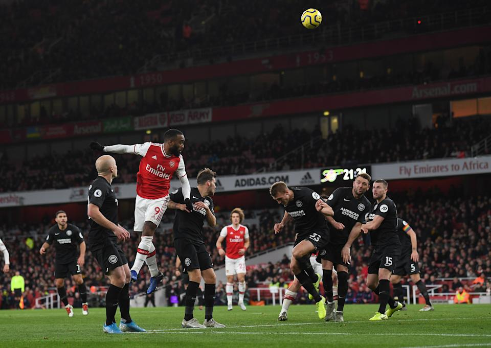 LONDON, ENGLAND - DECEMBER 05: Alexandre Lacazette scores Arsenal's goal during the Premier League match between Arsenal FC and Brighton & Hove Albion at Emirates Stadium on December 05, 2019 in London, United Kingdom. (Photo by David Price/Arsenal FC via Getty Images)