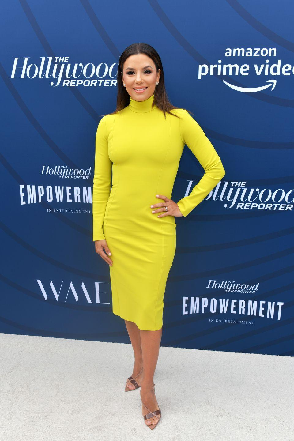 <p>Neon is one of the more intimidating '80s trends, but Eva Longoria pulls it off thanks to the length of this dress and simple accessories. </p>