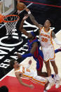Detroit Pistons forward Jerami Grant (9) has his shot blocked by Atlanta Hawks forward John Collins (20) as he drives into Trae Young (11) at the end of the second half of an NBA basketball game Wednesday, Jan. 20, 2021, in Atlanta. The Hawks won 123-115 in overtime. (AP Photo/John Bazemore)