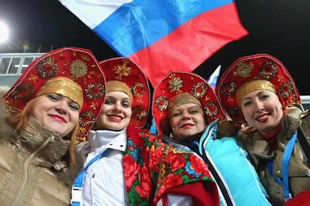 SOCHI, RUSSIA - FEBRUARY 08: Spectators smile during the Men's Sprint 10 km at day one of the Sochi 2014 Winter Olympics at Laura Cross-country Ski & Biathlon Center on February 8, 2014 in Sochi, Russia. (Photo by Alexander Hassenstein/Getty Images)