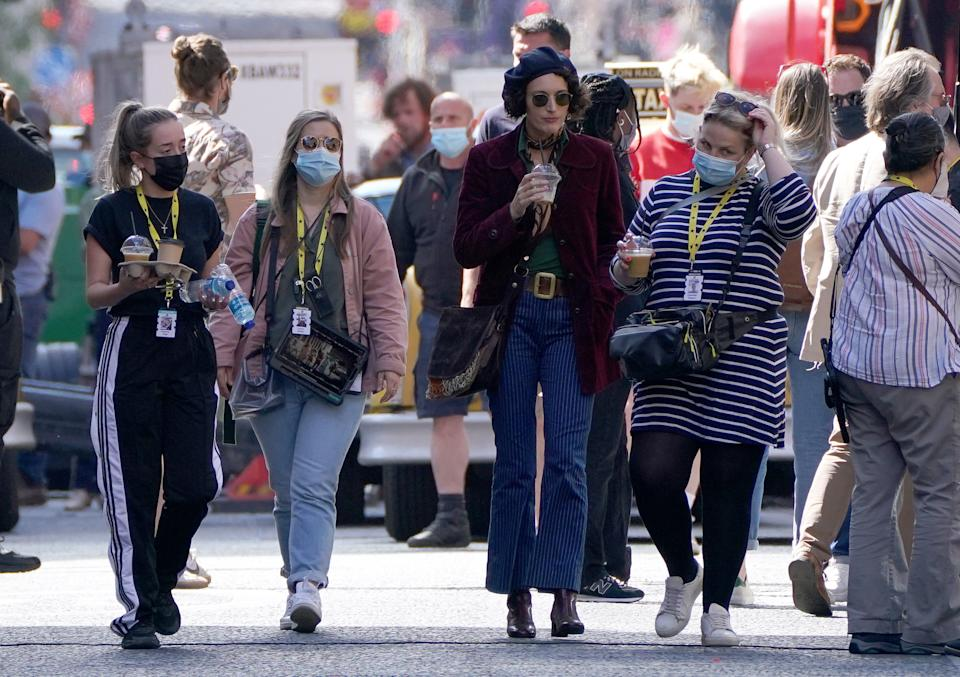 Actress Phoebe Waller-Bridge (third left) on Cochrane Street in Glasgow city centre during filming for what is thought to be the new Indiana Jones 5 movie starring Harrison Ford. Picture date: Wednesday July 14, 2021.