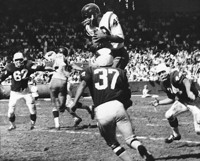 FILE - In this Oct. 15, 1962, file photo, Bobby Mitchell, of the Washington Redskins, jumps to haul in a pass from quarterback Norman Snead in the second period of their NFL football game against the St. Louis Cardinals in St. Louis. Mitchell, the speedy late 1950s and 60s NFL offensive star the Cleveland Browns and the Redskins, has died. He was 84. The Pro Football Hall of Fame said Sunday night, April 5, 2020, that Mitchells family said he died in the afternoon. (AP Photo/Fred Waters, File)