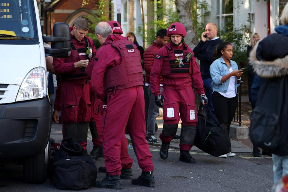 <p>Bomb disposal experts arrive on the scene in West London. (Reuters) </p>