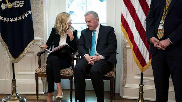 PHOTO: White House Press Secretary Kayleigh McEnany and Chief of Staff Mark Meadows talk in the Oval Office during a meeting with Iowa Governor Kim Reynolds and President Donald Trump, May 6, 2020. (Doug Mills/Pool via Getty Images)