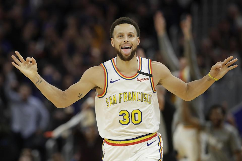 Golden State Warriors guard Stephen Curry (30) reacts after shooting a 3-point basket against the Toronto Raptors during the first half of an NBA basketball game in San Francisco, Thursday, March 5, 2020. (AP Photo/Jeff Chiu)