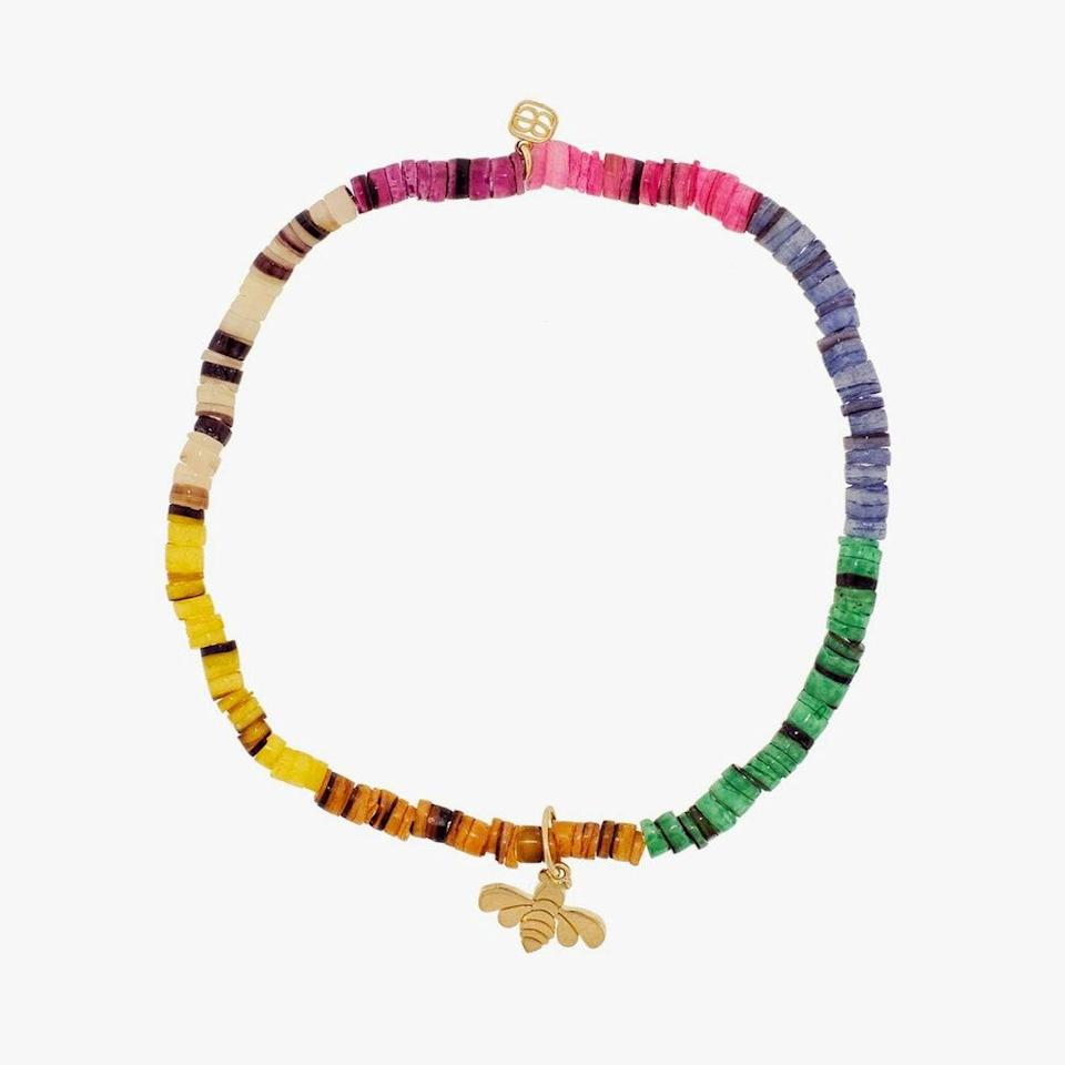 """$245, YLANG23. <a href=""""https://www.ylang23.com/products/tiny-pure-bee-charm-on-rainbow-heishi-beaded-bracelet"""" rel=""""nofollow noopener"""" target=""""_blank"""" data-ylk=""""slk:Get it now!"""" class=""""link rapid-noclick-resp"""">Get it now!</a>"""