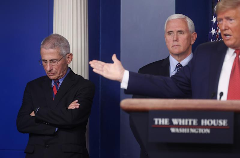 Dr. Anthony Fauci, Director of the National Institute of Allergy and Infectious Diseases and Vice President Mike Pence listen as U.S. President Donald Trump addresses the coronavirus task force daily briefing at the White House in Washington, U.S., March 25, 2020. REUTERS/Jonathan Ernst