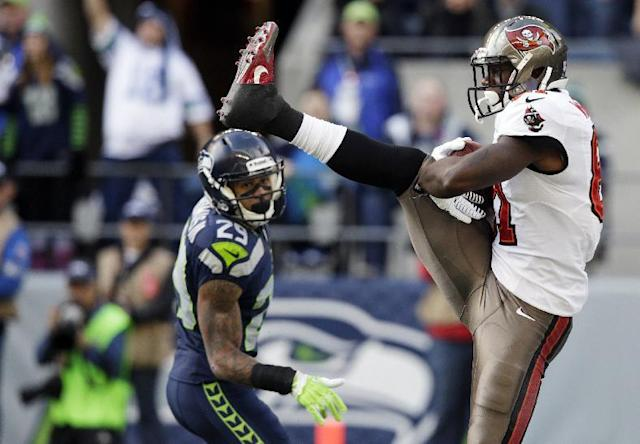 Tampa Bay Buccaneers tight end Timothy Wright, right, comes down with a catch for a touchdown as Seattle Seahawks free safety Earl Thomas stands at left, in the first half of an NFL football game Sunday, Nov. 3, 2013, in Seattle. (AP Photo/Stephen Brashear)