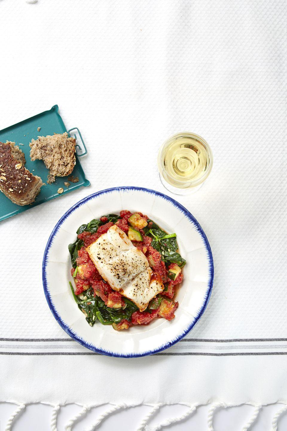 """<p>Check out the nutrition stats for this cod dish — 320 calories, 35 grams protein, 8 grams fat and 8 grams fiber — and feel good (<em>fine, </em>less guilty) about loading your plate with seconds.</p><p><em><a href=""""https://www.goodhousekeeping.com/food-recipes/a32410/mediterranean-cod-recipe-ghk0515/"""" rel=""""nofollow noopener"""" target=""""_blank"""" data-ylk=""""slk:Get the recipe for Mediterranean Cod »"""" class=""""link rapid-noclick-resp"""">Get the recipe for Mediterranean Cod »</a></em> </p>"""