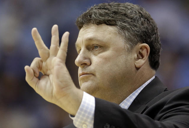 Oakland coach Greg Kampe directs his team during the first half of an NCAA college basketball game against North Carolina in Chapel Hill, N.C., Friday, Nov. 8, 2013. (AP Photo/Gerry Broome)