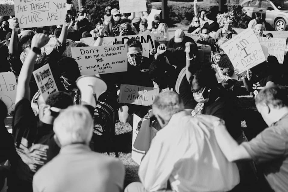 "<span class=""caption"">Lumbee Reverend Dr. Mike Cummings, center with his back to the camera, prays for protesters in Pembroke, North Carolina.</span> <span class=""attribution""><span class=""source"">Krista Davis</span>, <a class=""link rapid-noclick-resp"" href=""http://creativecommons.org/licenses/by-nd/4.0/"" rel=""nofollow noopener"" target=""_blank"" data-ylk=""slk:CC BY-ND"">CC BY-ND</a></span>"