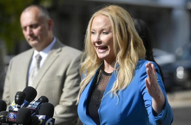 District attorney Stacy Park Miller talks to the media after a day of the preliminary hearing for the members of Beta Theta Pi charged in Piazza's death (Abby Drey /Centre Daily Times via AP)