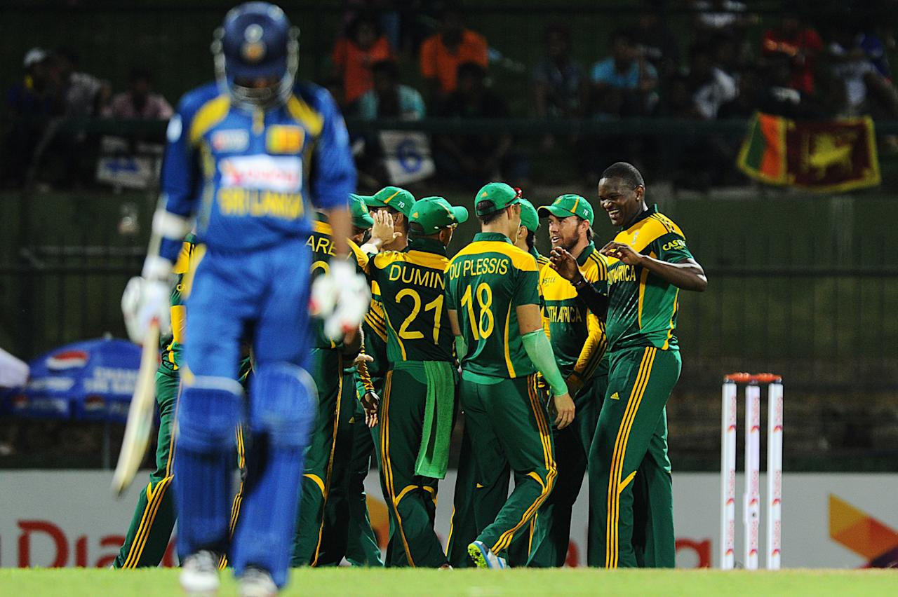 South African cricketers Lonwabo Tsotsobe (R) celebrates the wicket of  Sri Lankan cricketer Upul Tharanga (L) during the third One Day International (ODI) cricket match between Sri Lanka and South Africa at the Pallekele International Cricket Stadium in Pallekele on July 26, 2013. AFP PHOTO/ Ishara S.KODIKARA        (Photo credit should read Ishara S.KODIKARA/AFP/Getty Images)