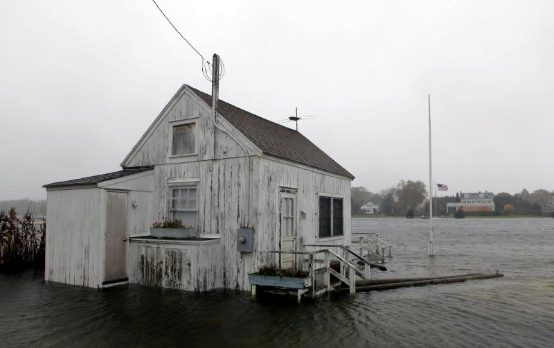 A house is inundated by flood water as Hurricane Sandy approaches, Monday, Oct. 29, 2012, in Center Moriches, N.Y. Hurricane Sandy continued on its path Monday, as the storm forced the shutdown of mass transit, schools and financial markets, sending coastal residents fleeing, and threatening a dangerous mix of high winds and soaking rain.  (AP Photo/Jason DeCrow)