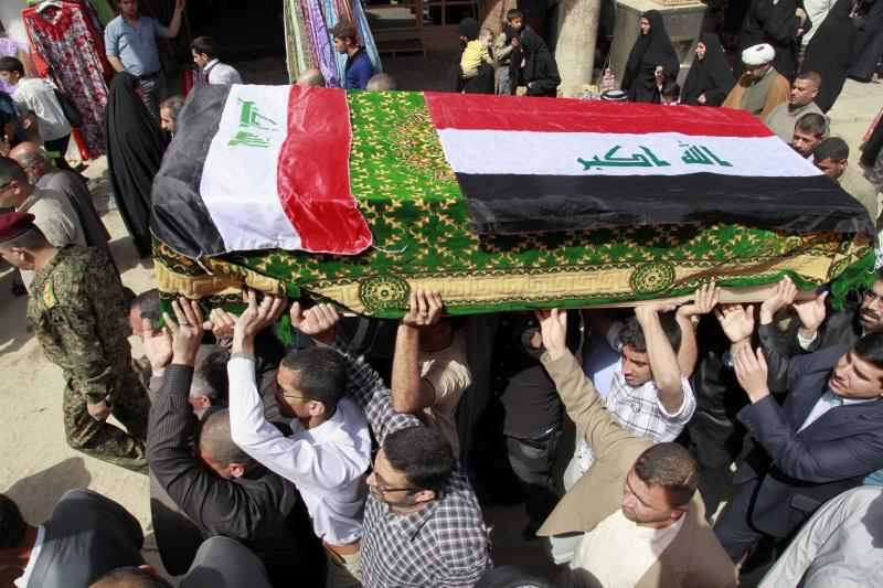 Mourners carry a coffin draped with Iraqi flags during the funeral procession for Shaima Alawadi in the Shiite holy city of Najaf, 100 miles (160 kilometers) south of Baghdad, Iraq, Saturday, March 31, 2012. Alawadi was an Iraqi-American woman found bludgeoned to death in her California home last week, with a threatening note left beside her body, was buried in her native Iraq on Saturday. (AP Photo/Hadi Mizban)