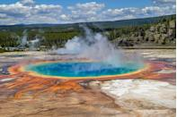 "<p>This <a href=""https://www.tripadvisor.com/Tourism-g60999-Yellowstone_National_Park_Wyoming-Vacations.html"" rel=""nofollow noopener"" target=""_blank"" data-ylk=""slk:3,500-sq.-mile national park"" class=""link rapid-noclick-resp"">3,500-sq.-mile national park</a> resides in both Wyoming and Idaho atop a volcanic hot spot. The park encompasses lush forests, dramatic mountains, and geysers, including the iconic <a href=""https://www.tripadvisor.com/Attraction_Review-g60999-d142956-Reviews-Old_Faithful-Yellowstone_National_Park_Wyoming.html"" rel=""nofollow noopener"" target=""_blank"" data-ylk=""slk:Old Faithful"" class=""link rapid-noclick-resp"">Old Faithful</a>. </p>"