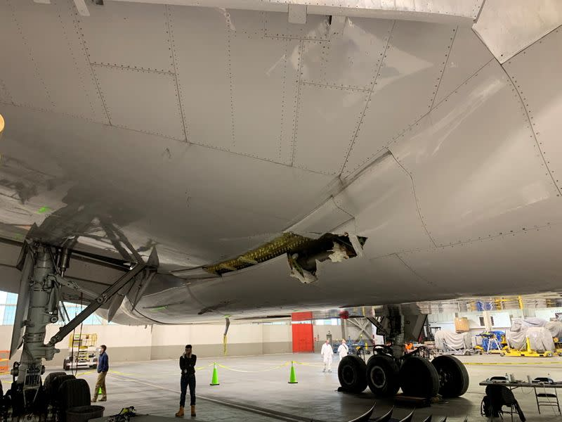 Damage to the wing and the body fairing of United Airlines flight 328 is seen following a February 20 engine failure incident