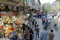 Iranians shop in the capital Tehran's Grand Bazaar in September 2020 as the economy faces intense US pressure
