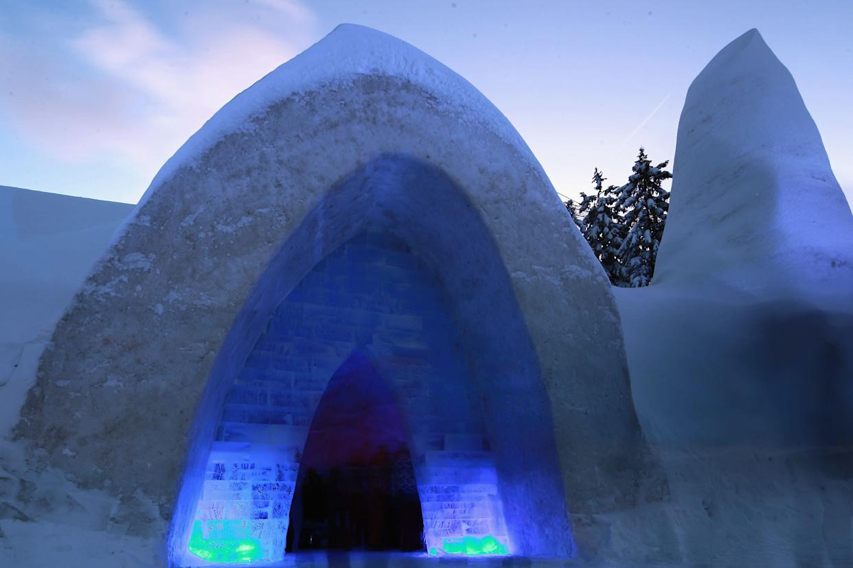 Visitors stand inside a church made entirely of snow and ice in southern Bavaria on Jan. 14, 2012, in Mitterfirmiansreut, Germany. Local enthusiasts built the church at the end of December in an effort to relive a tradition dating back over 100 years. In 1910 the residents of Mitterfirminsreut were cut off from their local parish by a heavy snowstorm, and since the village was without its own church, they were unable to attend Christmas mass. In January 1911, in an act of protest against local authorities whom they felt had forgotten them, the residents built their own church out of the material they had most in abundance at the time: snow.
