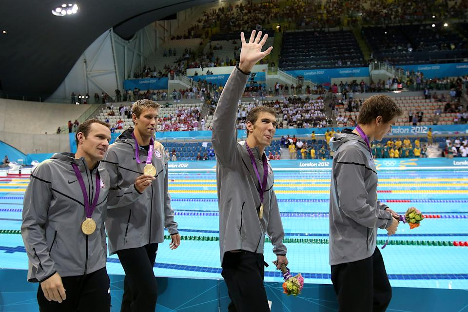 <b>Medal No. 22</b><br>Michael Phelps (C) of the United States waves to the crowd celebrating his 18th gold medal for the Men's 4x100m Meldey Relay Final on Day 8 of the London 2012 Olympic Games at the Aquatics Centre on August 4, 2012 in London, England. (Photo by Jeff Gross/Getty Images)