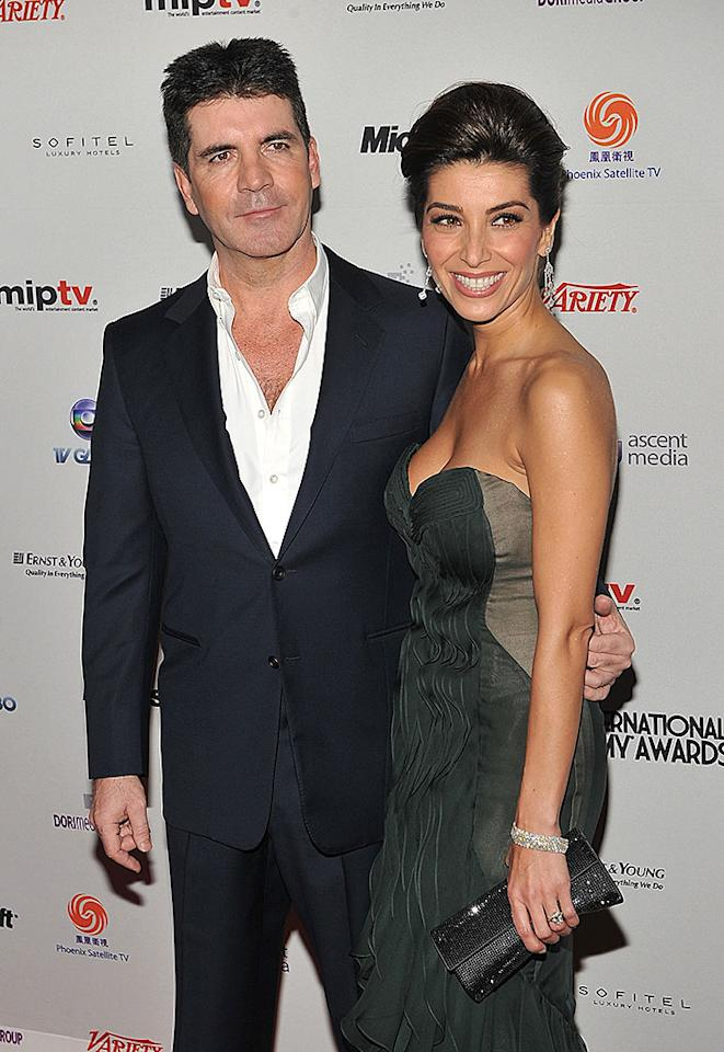 NEW YORK - NOVEMBER 22:  Simon Cowell and his fiancee Mezhgan Hussainy attend the 38th International Emmy Awards at the New York Hilton and Towers on November 22, 2010 in New York City.  (Photo by Theo Wargo/WireImage) *** Local Caption *** simon Cowell;Mezhgan Hussainy