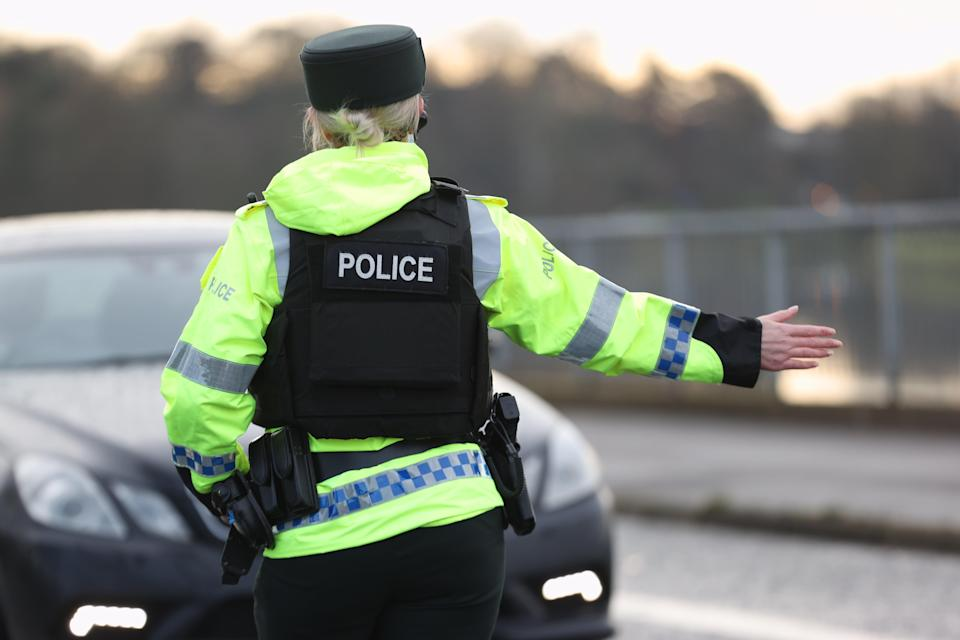 <p>The woman is a member of staff of the member of the Police Service of Northern Ireland</p> (PA Wire)
