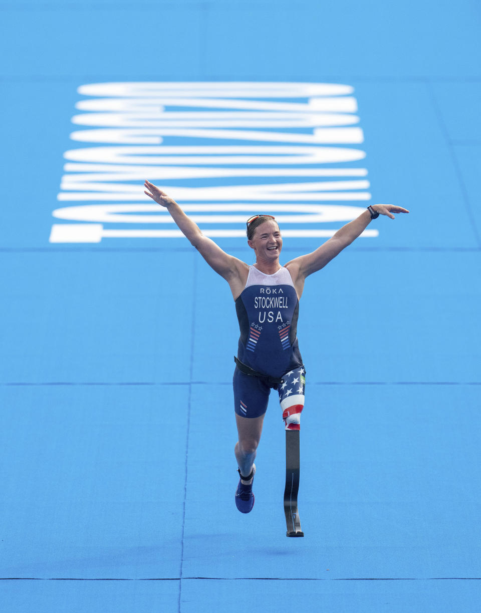 Melissa Stockwell, of the UnitesStates, approaches the finish line in the women's triathlon PTS2 at Odaiba Marine Park during the Tokyo 2020 Paralympic Games on Saturday, Aug. 28, 2021, in Tokyo. (Joe Toth for OIS via AP)