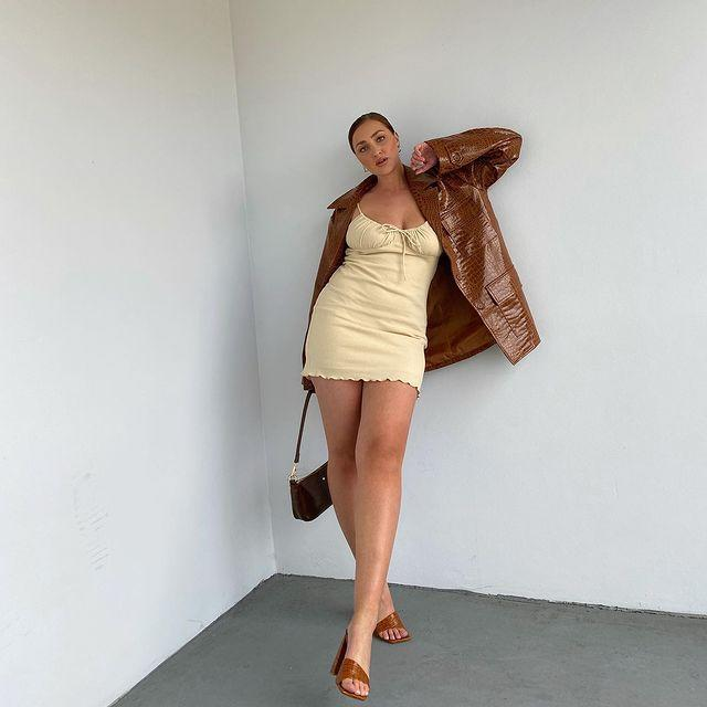 """<p>The short and chic look is a must this summer—it can take you from day to night, and when creamy caramel tones are included, like Mikayla Klewer wears here, it instantly becomes the perfect look.<br></p><p><a href=""""https://www.instagram.com/p/CE0-j3yA_0t/?utm_source=ig_embed&utm_campaign=loading"""" rel=""""nofollow noopener"""" target=""""_blank"""" data-ylk=""""slk:See the original post on Instagram"""" class=""""link rapid-noclick-resp"""">See the original post on Instagram</a></p>"""