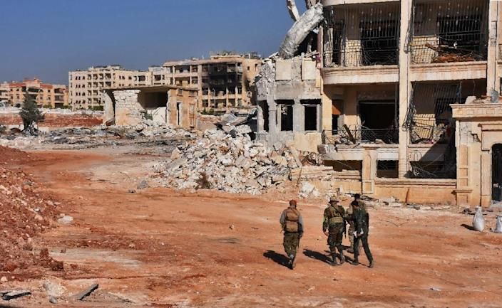 Syrian pro-regime troops patrol Aleppo's Minyan district after seizing it from rebel forces (AFP Photo/George Ourfalian)