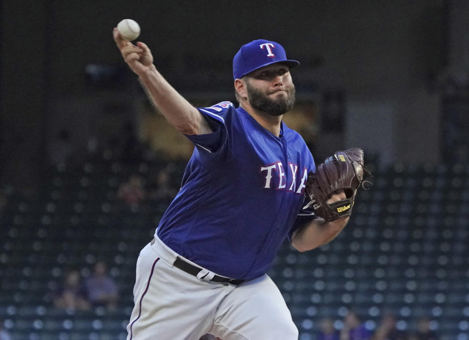 Texas Rangers' Lance Lynn pitches against the Seattle Mariners during the first inning of a baseball game Thursday, Aug. 29, 2019, in Arlington, Texas. (AP Photo/Louis DeLuca)