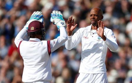 Cricket - England vs West Indies - First Test - Birmingham, Britain - August 18, 2017 West Indies' Roston Chase celebrates taking the wicket of England's Dawid Malan Action Images via Reuters/Paul Childs